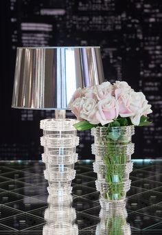 Large clear crystal vase with a modernist style typical of the Art Deco period. The horizontal bevel cut accentuates the decorative nature of this vase and creates delightful interplays of light.