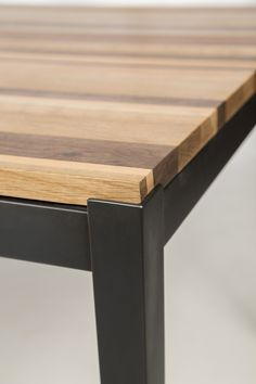 Manhattan Table with medley mixed wood top by McKinnon Furniture