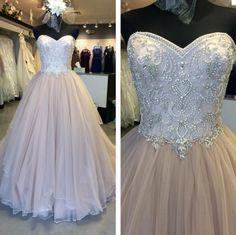 Blush, jeweled strapless wedding gown - weddingday-online.com