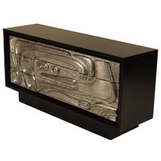 Striking Ebonized Sideboard with Silver Leafed Sculptural Relief Front   From a unique collection of antique and modern credenzas at https://www.1stdibs.com/furniture/storage-case-pieces/credenzas/