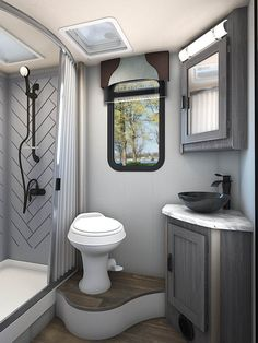 The Lance 2445 Travel Trailer has a large bathroom equipped with a spacious shower, a window, a medicine cabinet and a skylight! Travel Trailer Interior, Travel Trailer Living, Small Travel Trailers, Small Campers, Truck Camper, Camper Trailers, Lance Campers, Rv Show, Utility Trailer