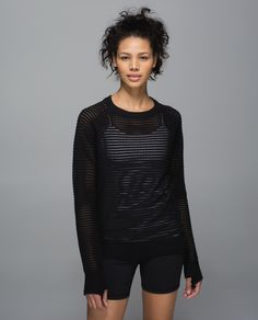 "Breathable and cottony-soft, this lightweight pullover is our new post-practice favourite. The loose fit layers easily over a tank and tights  when we're leaving the studio, and the open hole knit gives our sticky skin room to breathe after a particularly sweaty class. This is what we mean when we say ""hold on to your bliss."""
