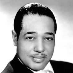 """An originator of big-band jazz, Duke Ellington was an American composer, pianist and bandleader who composed thousands of scores over his 50-year career, including """"Take the A-Train"""" in 1953."""