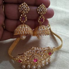 Beautiful one gram gold choker studded with white and pink color CZs. Necklace with pearl hangings. Choker with matching jumkhis. 05 March 2019
