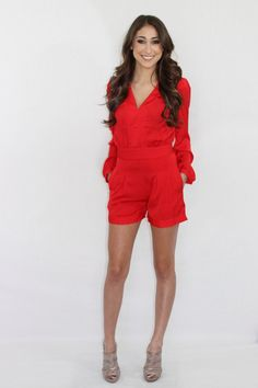 Sexy. Classy. And red. Really, you can't get any better with this gorgeous red romper. Zip up back, buttons at the sleeves, and pockets in the front. This romper does run about 2 sizes small so please