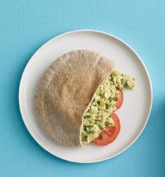 Breakfast pita. 347 calories. In a bowl, scramble 1 egg, 1 egg white, 1/4 cup chopped scallions; season with freshly ground black pepper. In a small skillet, cook egg mixture in 1 tsp olive oil, 3 minutes. Spread 1 tbsp light cream cheese inside a 6-inch whole-wheat pita pocket; stuff pita with egg mixture, 2 slices tomato.