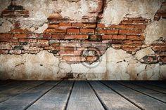 Fotobehang Gebarsten gips van oude bakstenen muur