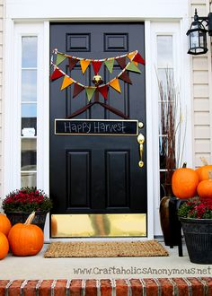 Banner made with bias tape and felt.  Simple!  I also like this sign on the door!  Could get chalkboard paint and make one and change it's saying for the holidays!