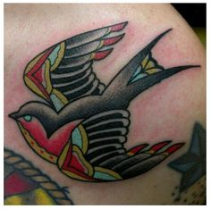 Traditional Swallow Tattoo by Zack Taylor at Evermore Tattoo.