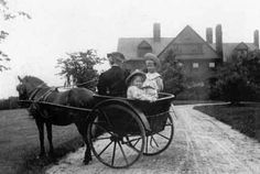 Kermit and Ethel Roosevelt, President Roosevelt's third and fourth in a total of six children, ride up to Sagamore Hill in a pony cart with their nanny, Mame.