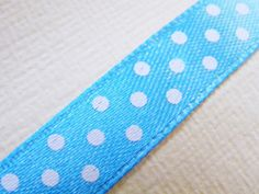 Pretty turquoise satin ribbon with dots