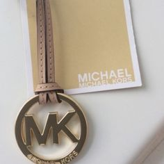 New Michael kors golden and tan charm ⬇️⬇️ Final price. Bundle and save Michael Kors Bags
