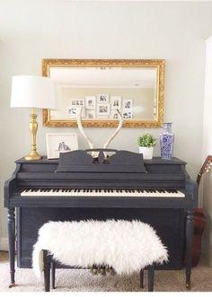 Annie Sloan chalk painted piano. Dark navy, gold, antlers visit sosimplydesign on Instagram.
