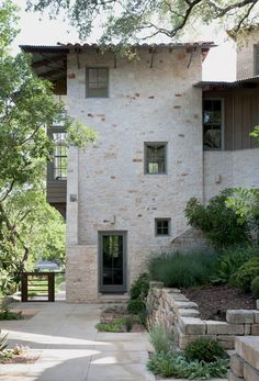 love the painted trim with the stone and metal roof.  paul lamb architects, austin, tx.