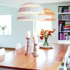 Rattan hanging lamp above a wooden kitchen table Weave   Malin Lundmark