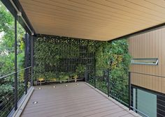 Skywalk version of a treehouse with built-in vertical garden. Casa CorMAnca by Paul Cremoux Studio.