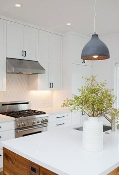 Fresh white kitchen with warm wood wrapped island, black cabinet pulls and Dwell patterns Heath tile backsplash . Photo 2 of Chenery Street Remodel modern home Kitchen Cabinet Colors, Kitchen Decor, Kitchen Design, Kitchen Cabinets, Kitchen Ideas, White Cabinets, Kitchen Lamps, Kitchen Board, Kitchen Counters