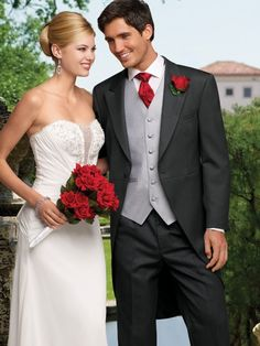 My fiancé likes the sharp suit and the red tie. Don't know how to incorporate this into a pastel theme...hummm