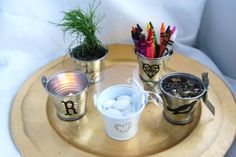 Five fun ways to use tiny tin pails as wedding favors. From @Jenny Rohrs