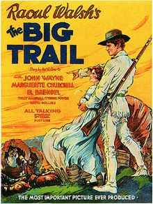 """The Big Trail -  release 1930 directed by Raoul Walsh with John Wayne, Tyrone Power Sr. etc.""""The story is about a large caravan of settlers in the very earliest days of the Oregon Trail, which from the early 1840s to 1869 was the main overland route from Missouri to the Pacific Northwest...In 2006, the United States Library of Congress deemed this film """"culturally, historically, or aesthetically significant"""". Shot in an early widescreen process using 70mm film."""