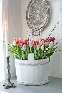 Beautiful wooden bucket of tulips and pussy willow