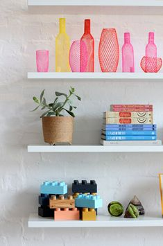 Neon vases on white shelves | http://decor8blog.com/2012/02/26/pop-up-shop-by-the-design-files/