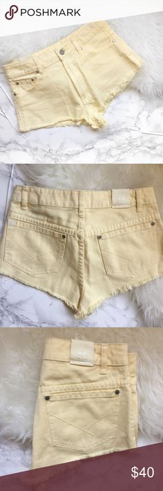 """Pastel yellow high waisted cutoff shorts Cute cutoff shorts. I bought these on Nastygal, never got around to wearing them. New without tags, never worn. I would say these run small. Waist is about 14"""" across the back. No trades Nasty Gal Shorts Jean Shorts"""