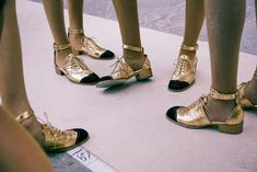 Gold strap brogues backstage at Chanel SS15 PFW. More images here: http://www.dazeddigital.com/fashion/article/22030/1/chanel-ss15