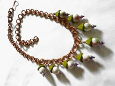 ceramic & glass beads on handmade copper chain.