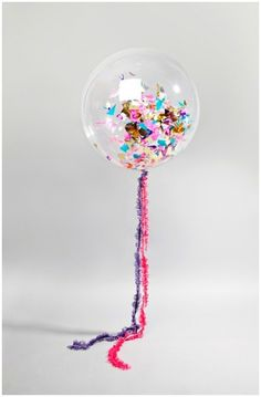 Transparent balloon filled with chunky confetti.