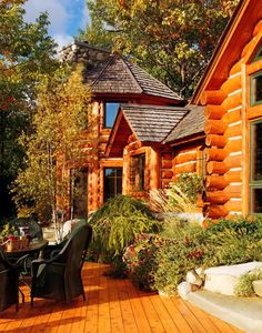 Rustic Log Cabin LOVE -->View side elevation offers an array of radial bays, gable dormers and large gables to take advantage of the views.
