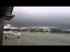 Lightning strikes directly in front of men filming a wild storm