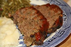 Slow Cooker Meatloaf - A moist meatloaf made with lean ground beef, onion, bell pepper, garlic and a crushed saltine binder, cooked in the crockpot. Served here with everyday mashed potatoes and southern green beans.