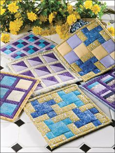 Through the Window pot holders FREE beginner quilt pattern download. Find this pattern at Free-Quilting.com.