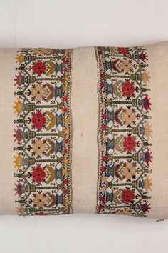 For Sale on 1stdibs - Pat McGann Workshop Antique Turkish embroidered, handwoven linen textile pillow. Silk floss and metallic wrapped thread embroidery. Two ends of a towel