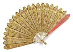 A rare Fabergé enamel fan with jewelled two-colour gold mounts, workmaster Henrik Wigström, St Petersburg, 1903, the front guard of translucent pink enamel over moiré engine-turning applied with a rose-cut diamond-set flower trail hung from a laurel festoon, the back guard and sticks of mother-of-pearl with piqué pellets, the silk leaf painted with pink roses within gold paillon borders, the loop of chased leaves, the hinge terminals set with diamonds.