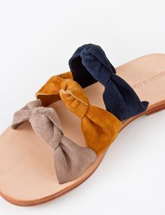 """Creatures of Comfort Sally is a three strap flat sandal in a suede leather with knot detailing. Leather insole Stacked wood sole Heel measures 0.5"""" Made in Peru"""
