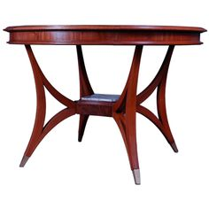 Italian Dining Room Table ca. 1960 | Stylish round Italian extension dining or center table,with two leaves, extending to 59 and 71 inches. The triangular shaped legs connecting to a center piece with a white Carrera marble inset.