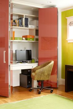 Small Apartment Design Idea - Create A Home Office In A Closet | Colorful doors conceal this home office with built-in shelves when it isn't being used.