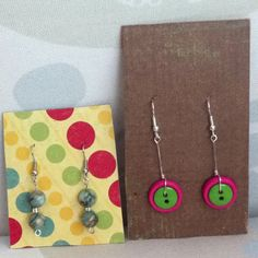 Recycled earring packaging: (scrap) scrapbook paper + punch a tiny hole=cute display for travel or to sale
