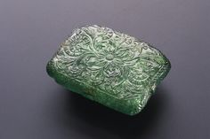 Translucent Green Emerald Amulet 1695-96 CE Mughal India. The Mughal rulers of South Asia held extensive treasuries of gemstones mined both within their own territories and abroad. Emeralds were...