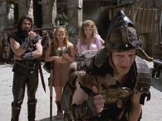 Ares, Gabriel, and Aphrodite using Joxer back as a table to figure out what next to put on the scroll to end there suffering. Queer As Folk, Xena Warrior Princess, Fresh Prince, Aphrodite, Hercules, Victorious, Tv Shows, Gabriel, Table