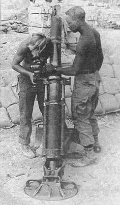 4.2 mortar round on it's way....  Ready to fireDEFLECTION AND ELEVATION ARE SET ON MORTAR TUBE
