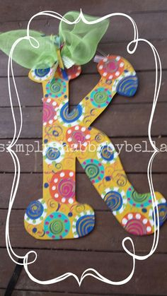 Personalized Initial Wood door hanger These letters are hand painted with acrylic paint & accented with glitter puffy paint . they are made to your order, so feel free to customized any way you want. They are sealed to withstand the weather. All letters include a Mesh or Burlap