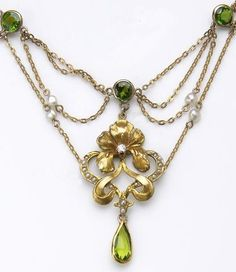 An Art Nouveau peridot, diamond, seed pearl and fourteen karat gold necklace, circa 1900. The festoon necklace designed with a pendant of floral motif, set with seed pearls and a European-cut diamond, suspending as collet-set pear-shaped peridot, the swags highlighted by pearls and collet-set round facet-cut peridot; length: 17in.