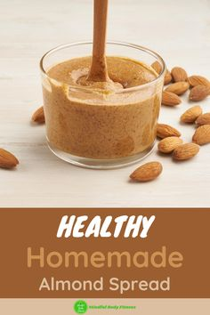 Healthy Homemade Almond Spread: making your own almond butter is a brilliant way to get the awesome health benefits of nuts from delicious spreadable nut butter. This almond nut butter is rich in vitamin, B2, vitamin E, magnesium, copper, and healthy fats, protein, and fiber. Don't be tempted by cheap supermarket-bought spreads which can often be loaded with calories and sugar - grab this healthy almond nut butter recipe. #almondbutter #almondbutterspread #almondbutterrecipe #nutbutter