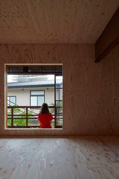 Century-old Japanese house lined with unfinished plywood.