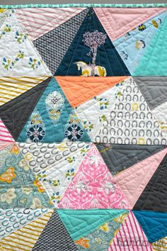 Modern Handcraft - Fall Quilt Market 2014 // Art Gallery Fabrics - interesting use of triangle to make up half part of square