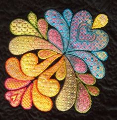 Heather Feather, Detail 1 | Textile Treasures | Nancy WickVIEWER'S CHOICE award winner at Minnesota Quilt Show 2011; Pieced, embroidered, and quilted by Nancy Wick; Design source for embroidery = Heather Feather by Sarah Vedeler; Applique fabric is hand painted by Nancy Wick