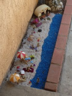 Beach fairy garden in a side yard along the house-Lisa maybe...